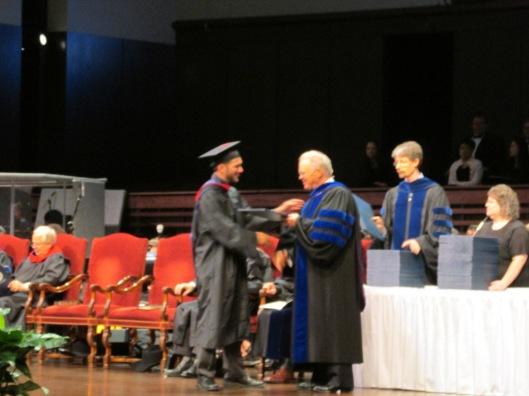 John receiving diploma
